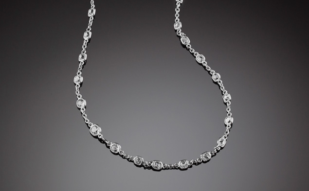 An Art Deco fine platinum chain and extension chain both set with old european cut diamonds