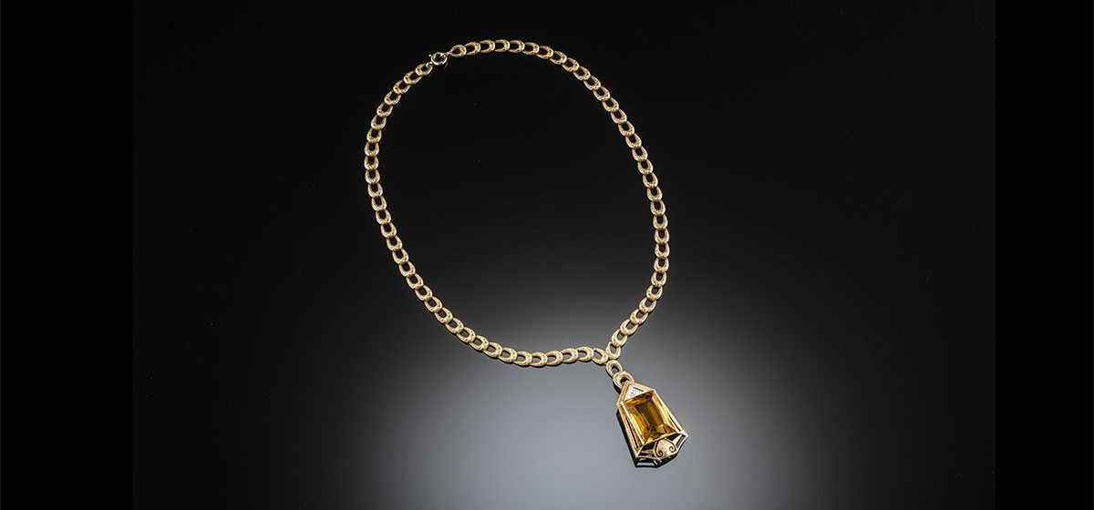 An art deco citrine diamond and yellow gold pendant james alfredson an art deco citrine diamond and yellow gold pendant aloadofball Image collections