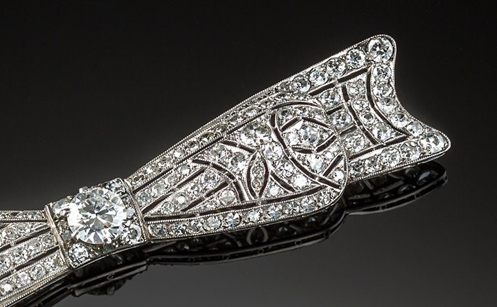 An Art Deco handcrafted platinum and diamond elongated bow brooch