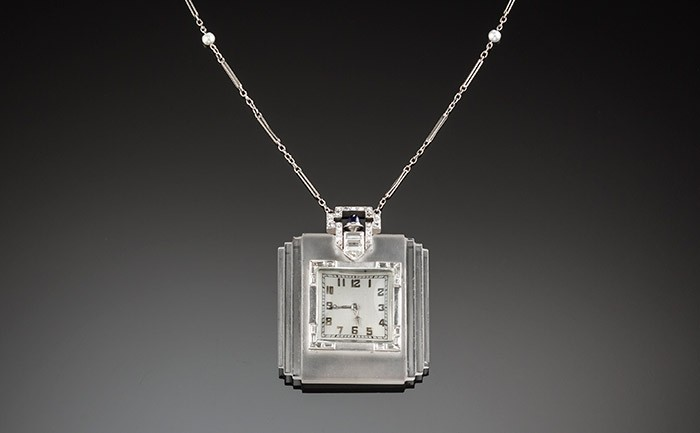 An Art Deco rock crystal diamond and platinum pendant watch and chain