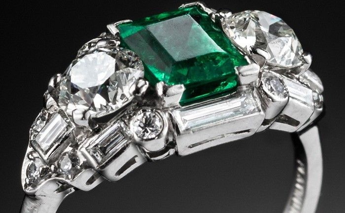 Detail of a fine Art Deco vivid green emerald and diamond ring