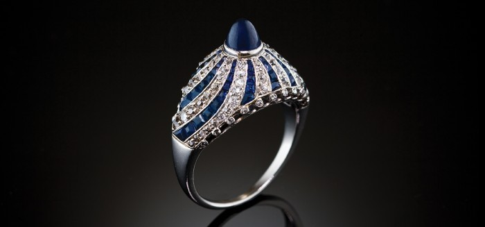 An Art Deco diamond and sugarloaf cabochon sapphire ring