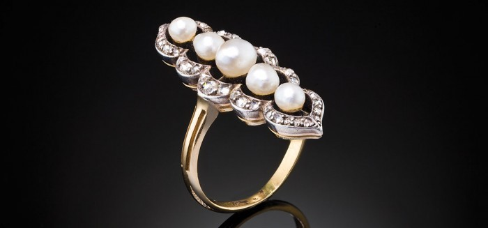An antique natural pearl and diamond ring