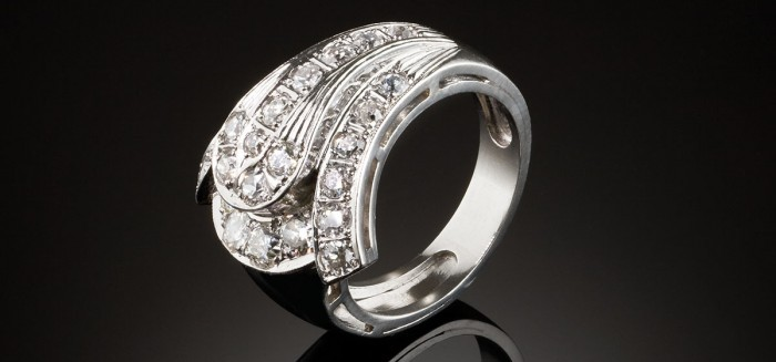 A late Art Deco diamond buckle ring