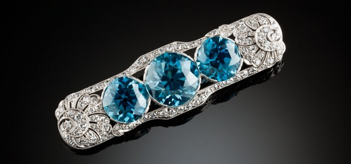 Art Deco blue zircon and diamond platinum brooch. Walton & Co