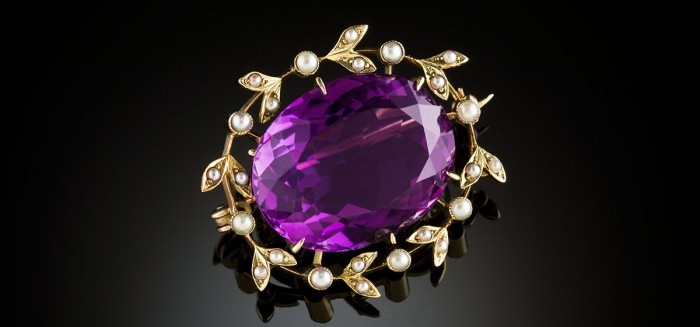 Antique faceted amethyst (estimated weight 35ct.) and seed pearl brooch