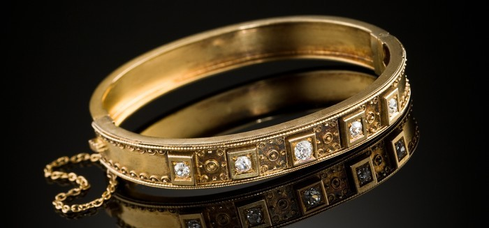 An Antique Etruscan Revival diamond and gold bangle