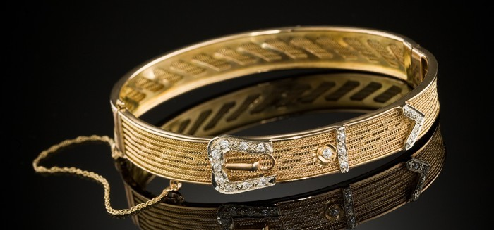 An antique diamond and yellow gold hinged buckle design bangle