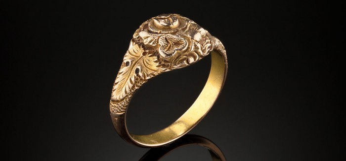 A handmade antique gold and gilt floral carved signet ring