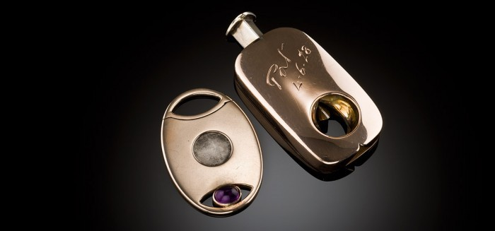 An art deco rose gold cigar cutter