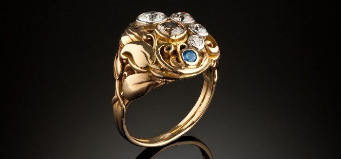 An Arts and Crafts gold, diamond and sapphire handmade ring