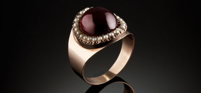An antique gold garnet and seed pearl mourning ring