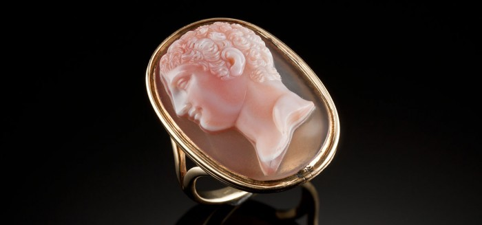 A large antique cameo ring in a yellow gold setting