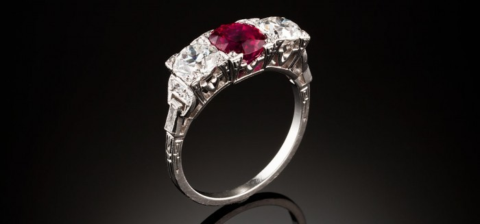 An Art Deco ruby and diamond three stone ring
