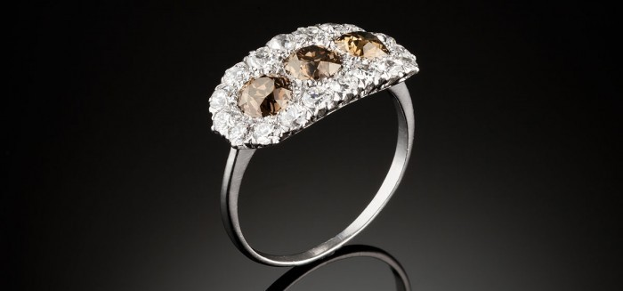 An early twentieth century deep champagne and white diamond plaque style ring