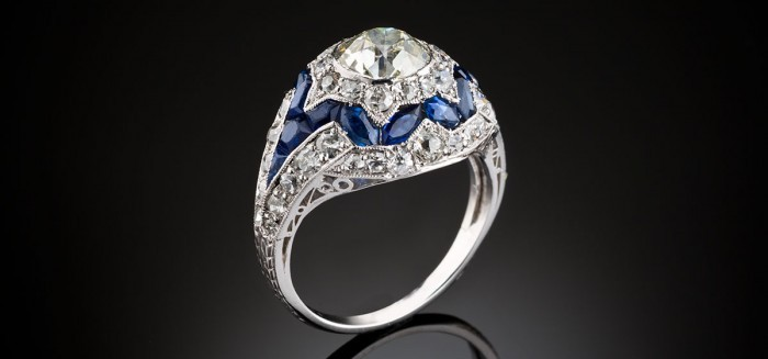 A diamond and sapphire early Art Deco bombe ring