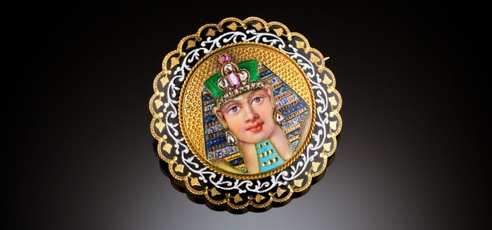 An antique Egyptian Revival gold enamel and gem-set brooch