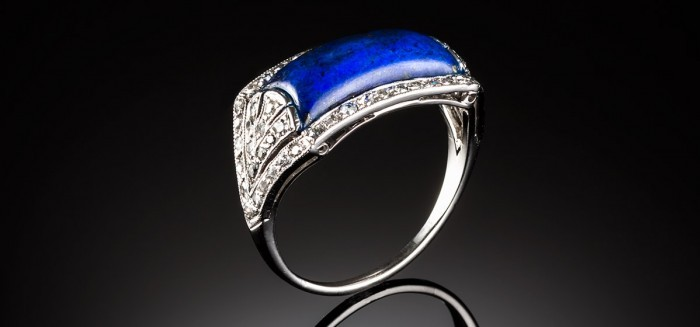 A French Art Deco lapis lazuli and diamond saddle style ring