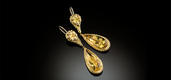 Earrings of antique yellow gold surmounts and large faceted yellow beryl drops