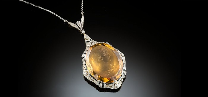 An early twentieth century citrine intaglio diamond and onyx necklet