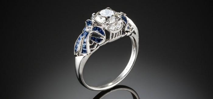 A diamond and sapphire bow ring