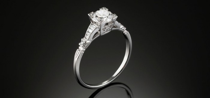 An Art Deco solitaire transition cut and graduated baguette cut diamond ring