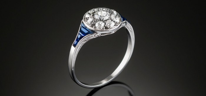 A classic art deco diamond sapphire and platinum round cluster ring