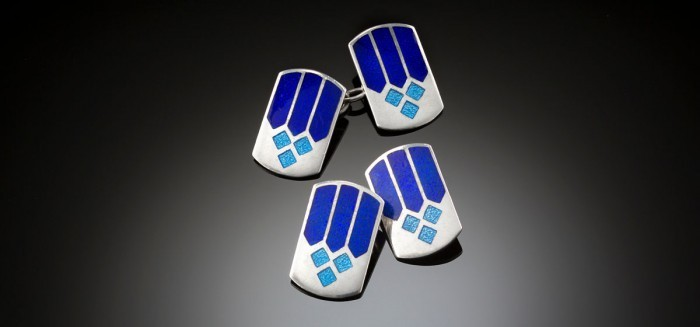An Art Deco pair of silver and blue enamels rounded oblong cufflinks