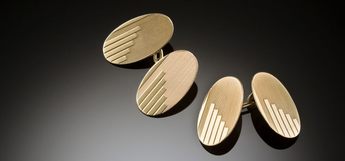 A mid century pair of double face yellow gold cufflinks with engine turning