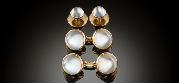 An early twentieth century pair of French double moonstone and gold sugarloaf cabochon cufflinks