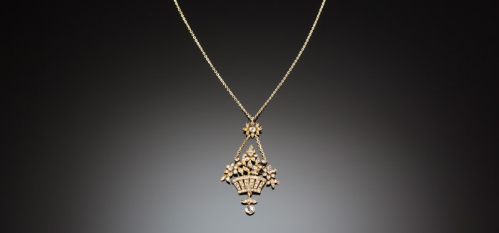 An Antique yellow gold and diamond set flower basket pendant/brooch