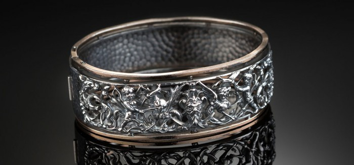 A rare antique French silver and heavy rose gold vermeil bangle