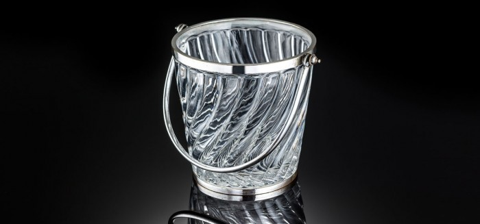An antique Baccarat crystal and silver plate ice bucket