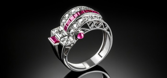 An Art Deco ruby and diamond ring with a curved top