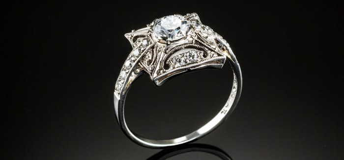 An early twentieth century square plaque platinum and diamond ring