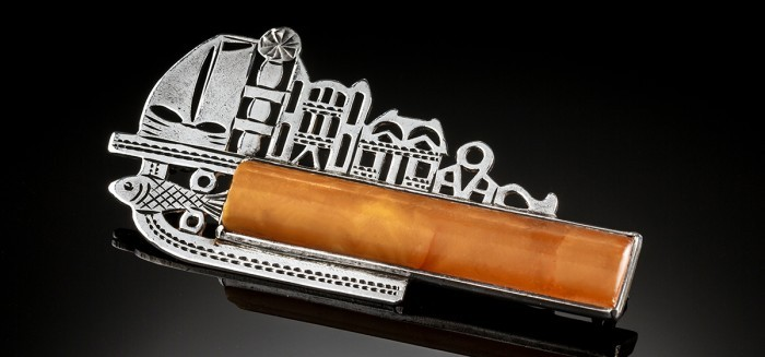 An Art Deco Pictorial brooch in amber and silver