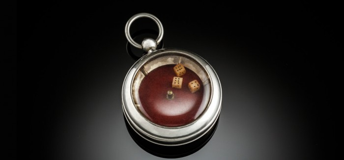 A Vintage pocket dice gambling device in pocket watch design