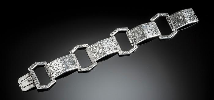 An Art Deco silver engraved link bracelet