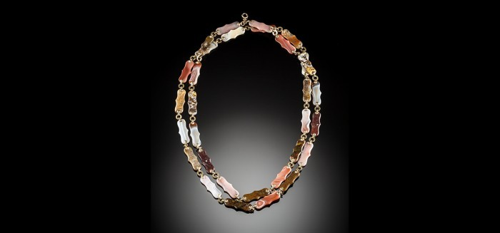 An antique long chain of flat polished multi coloured hardstones panels