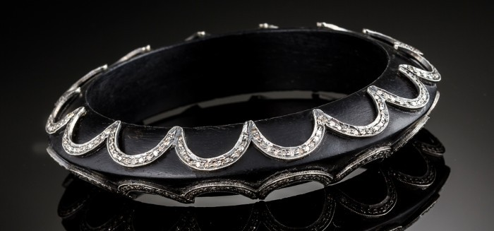 An Art Deco ebony and diamond set bangle