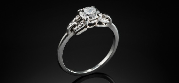 An Art Deco Cartier mounted diamond set platinum ring in the original Cartier presentation box