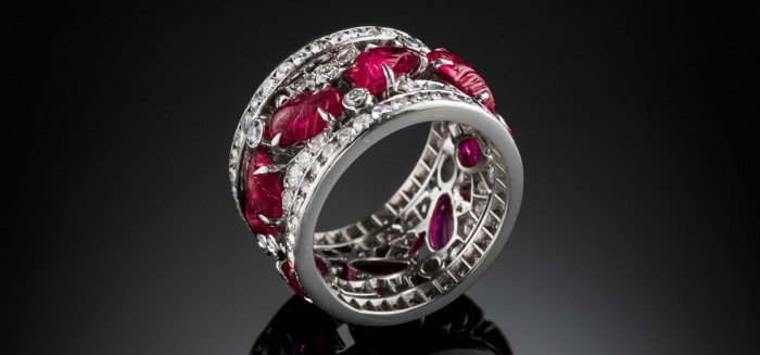 An Art Deco platinum diamond band with carved rubies