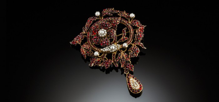 A large Antique garnet and pearl brooch