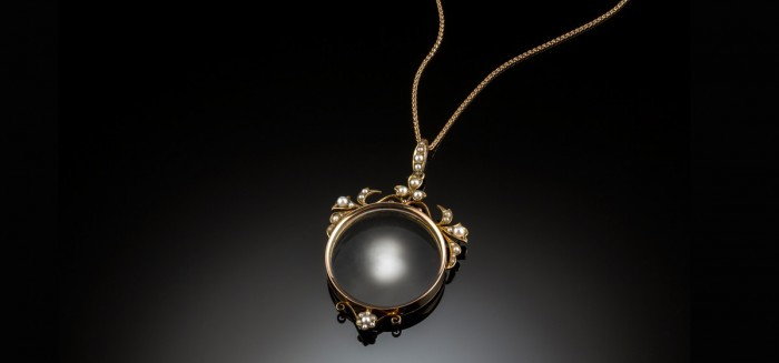 A fine Antique Australian photograph locket in yellow gold and seed pearls by goldsmiths, Hall & Co