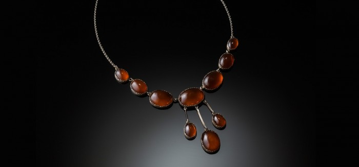An Arts and Crafts carnelian and silver necklace