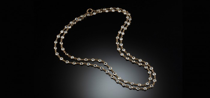 An Art Deco paste and gilt long chain