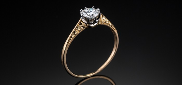 A 1930s solitaire old cut diamond ring set in yellow gold