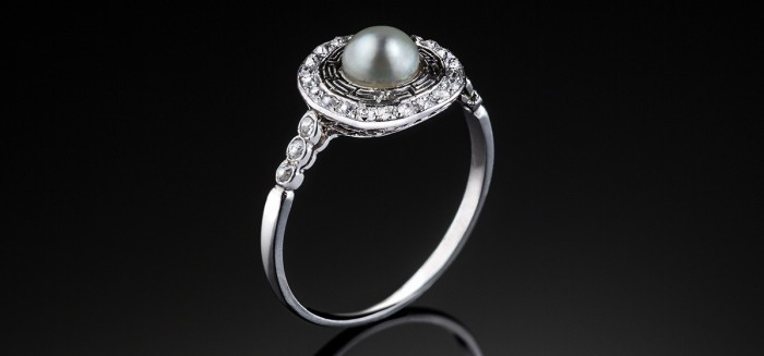 A Belle Epoque pearl and old cut diamond platinum set fine ring