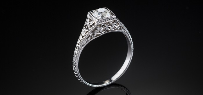 An Early Twentieth Century solitaire old cut diamond ring in an orange blossom platinum mount