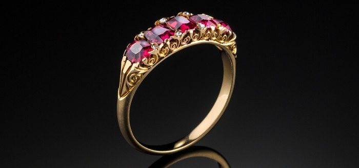 An Antique yellow gold ruby and diamond half hoop ring